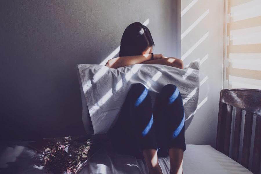 woman sad periods